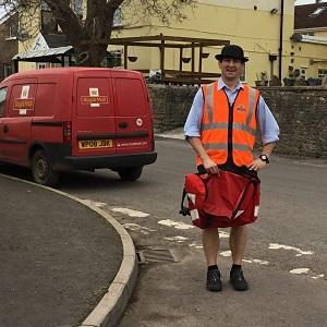 Draycott village postman on his rounds at the foot of the Mendip Hills in Somerset